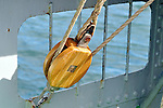 Close up of wooden block and tackle pulley with rope on sailing ship