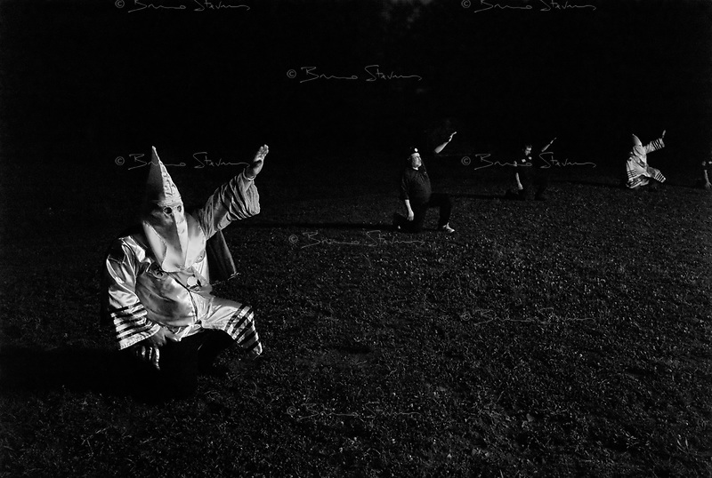 "near Prospect, TN, USA , May 9th 2009.""Cross Burning"" is one of the most well known rituals of the Ku Klux Klan, it has to take place on private ground, as it it is theoretically forbidden. Since President Obama was elected on Nov. 4th, 2008, the Ku Klux Klan has seen new memberships applications being multiplied by 6 compared to the previous year!"