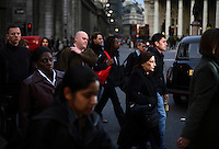 People employed in the City of London in the early evening rush hour outside Bank station. The UK went into recession in the final quarter of 2008 as the City was hit hard by the global credit crunch.