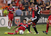 WASHINGTON, DC. - AUGUST 22, 2012:  Lionard Pajoy (26) of DC United loses the ball to a sliding tackle from  Pavel Pardo (17) of the Chicago Fire during an MLS match at RFK Stadium, in Washington DC,  on August 22. United won 4-2.