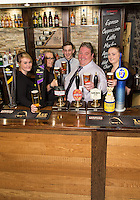 Pictured from left are  Samantha Adams, Rachael Weaver, Ben Lovegrove, owner Michael Perry, and Lois Hayes at The Fountain Bridge carvery restaurant and pub in Kirkby in Ashfield, Nottinghamshire.