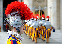Pontifical Swiss Guard;Pope Francis delivers the Urbi et Orbi (to the city and to the world) Christmas Day message from the central balcony of St. Peter's Basilica in Vatican City, 25 December 2013