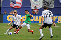 Fausto Pinto (5) of Mexico (MEX) is marked by Stuart Holden (10) of the United States (USA). Mexico (MEX) defeated the United States (USA) 5-0 during the finals of the CONCACAF Gold Cup at Giants Stadium in East Rutherford, NJ, on July 26, 2009.