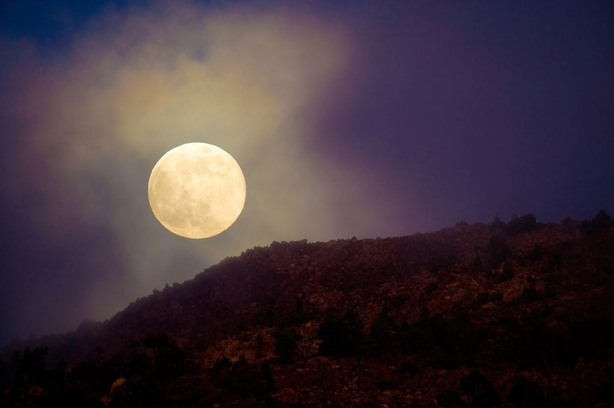 Full moon over the Teide Volcano, Teide National Park,  Tenerife Island, Canary Islands, Spain.