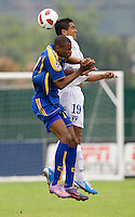 Joshua Nieto (19) of Honduras goes up for a header against Zari Prescod (17) of Barbados during the group stage of the CONCACAF Men's Under 17 Championship at Catherine Hall Stadium in Montego Bay, Jamaica. Honduras defeated Barbados, 2-1.