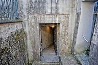 Roma 25 Ottobre 2014<br /> Aperti al pubblico i bunker segreti, costruiti tra il 1942 e il 1943,dove Benito  Mussolini e la sua famiglia cercava rifugio dai bombardamenti degli alleati nella residenza privata di Villa Torlonia. <br /> Nella foto: Una delle entrate del bunker.  Il bunker scavato ex novo ad una profondit&agrave; di 6 metri e mezzo, sotto  il piazzale antistante il Casino Nobile a forma di croce, protetto  da una copertura in cemento armato spessa  4 metri, la costruzione inizio  a fine 1942 ma rimase incompiuto poich&egrave; Mussolini fu arrestato il 25 Luglio 1943.<br /> Rome October 25, 2014 <br /> Open to the public the secret bunkers built between 1942 and 1943, where Benito Mussolini and his family sought refuge from Allied bombing in the private residence of Villa Torlonia. <br /> Pictured: One of the entrances to the bunker.The bunker dug anew to a depth of 6 feet below the square in front of the Casino Nobile in the shape of a cross, protected by a reinforced concrete roof 4 feet thick, construction beginning in late 1942 but remained unfinished because Mussolini was arrested July 25, 1943.