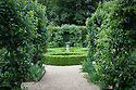 Sundial at centre of low box-hedged knot garden, Clinton Lodge Garden, Fletching, East Sussex, mid June.