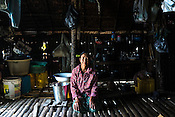 A fisherwoman poses for a portrait in her house in Kant Ma Lar Chang Village in Pyapon district of Myanmar.