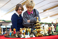 NWA Democrat-Gazette/JASON IVESTER <br /> Rene Bladon (left) and Marie Carlson, both church members, look over one of the Nativity scenes on Monday, Dec. 7, 2015, inside the First United Methodist Church of Bella Vista. About 70 various Nativity scenes owned by the church's members were on display for the evening.