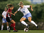 UNC's Elizabeth Guess (30) takes on NC State's Mandela Schumacher-Hodge (2) on Thursday, October 20th, 2005 at Fetzer Field in Chapel Hill, North Carolina. The University of North Carolina Tarheels defeated the North Carolina State University Wolfpack 1-0 during an NCAA Division I Women's Soccer game.