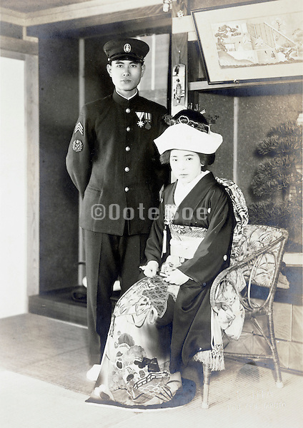 formal portrait of soldier and wife during wedding 1930s 1940s