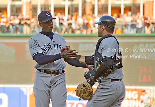 New York Yankees relief pitcher Aroldis Chapman (54) and catcher Austin Romine (27) congratulate each other following their team' 7 - 3 victory over the Baltimore Orioles at Oriole Park at Camden Yards in Baltimore, MD on Sunday, April 9, 2017.  <br /> Credit: Ron Sachs / CNP<br /> (RESTRICTION: NO New York or New Jersey Newspapers or newspapers within a 75 mile radius of New York City)