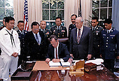 United States President George H.W. Bush at the Proclamation signing ceremony for Asian/American Heritage Month in the Oval Office of the White House in Washington, DC on May 6, 1991.  Pictured to the immediate left of the President is US Senator Daniel Inouye (Democrat of Hawaii).<br /> Mandatory Credit: Susan Biddle / White House via CNP
