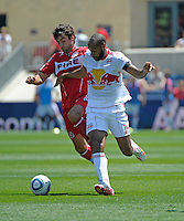 Chicago midfielder Baggio Husidic (9) battles for the ball with New York forward Thierry Henry (14).  The Chicago Fire tied the New York Red Bulls 1-1 at Toyota Park in Bridgeview, IL on June 26, 2011.