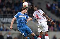 Fussball 1. Bundesliga 2012/2013: Relegation  Bundesliga / 2. Liga  TSG 1899 Hoffenheim  - 1. FC Kaiserslautern          23.05.2013 David Abraham (li, TSG 1899 Hoffenheim) gegen Mohamadou Idrissou (re, 1. FC Kaiserslautern)