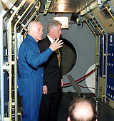 United States President Bill Clinton is pictured inside the Spacelab mock up during a tour conducted by U.S. Senator John H. Glenn (Democrat of Ohio), currently in training as a Space Shuttle crew member at the Johnson Space Center (JSC)..Credit: NASA via CNP