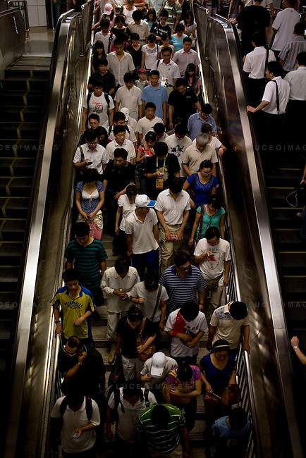 Subway passengers make their way to an Olympic venue in Beijing, China on Wednesday, August 20, 2008.  Kevin German