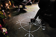 A Cuban man, the Palo religion follower, draws a magical symbol on the floor of the temple in Santiago de Cuba, Cuba, August 1, 2009. The symbol is the key element to release the spiritual powers linked to the altars. The Palo religion (Las Reglas de Congo) belongs to the group of syncretic religions which developed in Cuba amongst the black slaves, originally brought from Congo during the colonial period. Palo, having its roots in spiritual concepts of the indigenous people in Africa, worships the spirits and natural powers but can often give them faces and names known from the Christian dogma. Although there have been strong religious restrictions during the decades of the Cuban Revolution, the majority of Cubans still consult their problems with practitioners of some Afro Cuban religion.
