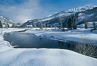 Pristine landscape of mountain valley and  Crystal River of Colorado in winter snow