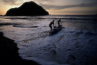 Kayakers launch into the Pacific Ocean waters to paddle on a calm morning along California's north coast.