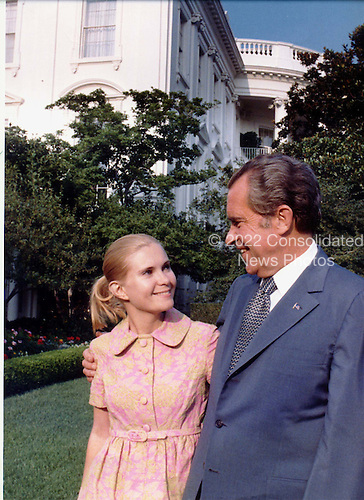 Washington, DC -- White House photo from 7 August, 1974 showing United States President Richard M. Nixon in the Rose Garden at the White House with his daughter, Tricia (Nixon) Cox prior to his announcing his resignation from the Presidency..Credit: The White House / CNP