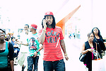 Rapper Waka Flocka walks through Lenox Square Mall after picking up a pair of Nikes in Atlanta, Georgia August 17, 2010..