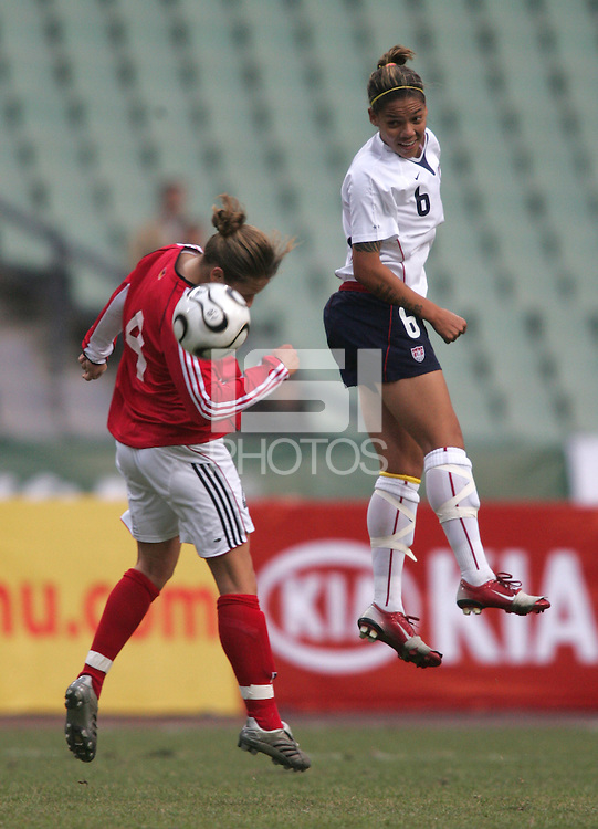 January 26, 2007: USWNT forward (6) Natasha Kai heads the ball over Germany's (4) Babett Peter during the Four Nations Tournament at Guangdong Olympic Stadium in Guangzhou, China. The match ended in a draw, 0-0.