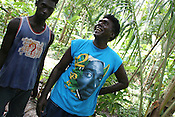 "Islanders in the ""garden"", one wearing a Tupac Shakur t-shirt, on Han Island, Carteret Atoll, Papua New Guinea, on Sunday, Dec. 10, 2006."