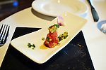 "On the day the Town Crier visited, Song was experimenting with a ""bonus course,"" Ahi tuna and Santa Barbara prawn seasoned with lemon and ponzu sauce. Wasabi caviar and fresh herbs completed the tower, and a whiff of truffle oil pervaded the scene."