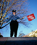 Crossing Guard Holds a Stop Sign.