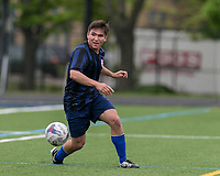 Malden, Massachusetts - May 13, 2017: In a National Premier Soccer League (NPSL) match, Boston City FC (red/white) tied Rhode Island Reds FC (black/blue), 3-3, at Brother Gilbert Stadium.