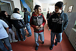 """THIS PHOTO IS AVAILABLE AS A PRINT OR FOR PERSONAL USE. CLICK ON """"ADD TO CART"""" TO SEE PRICING OPTIONS.   Bajram Kruezi (center) walks in the hallway with other students at the Branko Pesic School, an educational center for Roma children and families in Belgrade, Serbia, which is supported by Church World Service. Kruezi's family came to Belgrade as refugees from Kosovo, and like many Roma can't afford regular school fees. Many Roma also lack legal status in Serbia, and thus have difficulty obtaining formal employment and accessing government services."""