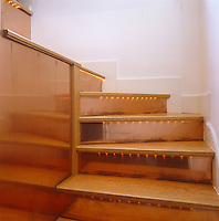 This staircase and short flight of steps are lined with copper and tubes of fairy lights illuminate each wooden tread