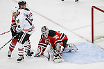 Mar 17, 2009; Newark, NJ, USA; New Jersey Devils goalie Martin Brodeur (30) makes a save during the first period of their game against the Chicago Blackhawks at the Prudential Center.