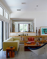 In a large open-plan Florida house two discreet living spaces are both separated and linked by a low partition