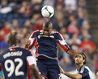 New England Revolution defender Andrew Farrell (2) heads the ball.  In the first game of two-game aggregate total goals Major League Soccer (MLS) Eastern Conference Semifinal series, New England Revolution (dark blue) vs Sporting Kansas City (light blue), 2-1, at Gillette Stadium on November 2, 2013.