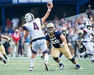 Annapolis, MD - SEPT 10, 2016: Connecticut Huskies quarterback Bryant Shirreffs (4) throws a pass over Navy Midshipmen nose tackle Jackson Pittman (99) during their match up at Navy-Marine Corps Memorial Stadium in Annapolis, MD. Navy held on to defeat Connecticut 28-24. (Photo by Phil Peters/Media Images International)