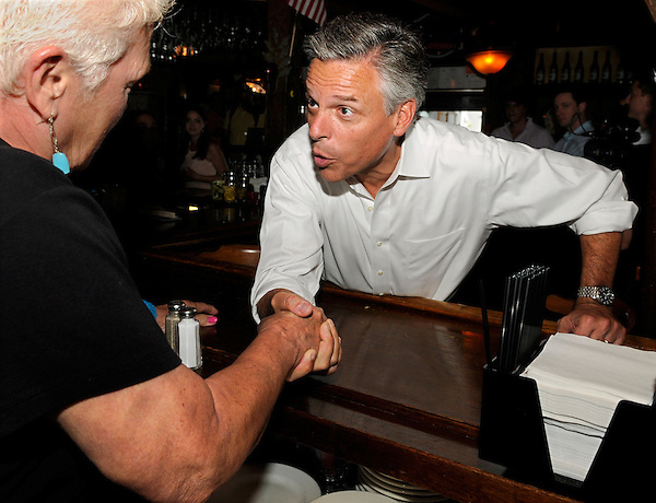 Hampton, New Hampshire: September 14, 2011<br /> Presidential candidate Jon Huntsman Jr. greets a bartender while campaigning inside the 401 Tavern during a downtown walking tour. &copy;Chris Fitzgerald / Candidate Photos