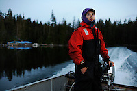 Shirley Ecklund is bundled up in a warm coat and hat as she drives her boat in to Thorn Bay, the closest town on Prince of Wales Island.  She has lived 12 years in a  float house where transportation is only by boat or float plane.  She used to cook for logging camps.