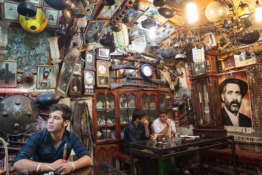 Young Iranians enjoying shisha inside the eccentric Azadegan chaykhaneh (teahouse) near the Imam Square of Isfahan.