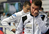 European Championships Fencing 2010 / Fecht Europameisterschaft 2010 in Leipzig - Competition Championat d'europe - im Bild: mens epee team - Jörg Fiedler (l.) and Martin Schmitt after losing the match. Foto: Norman Rembarz..Norman Rembarz , Autorennummer 41043728 , Augustenstr. 2, 04317 Leipzig, Tel.: 01794887569, Hypovereinsbank: BLZ: 86020086, KN: 357889472, St.Nr.: 231/261/06432 - Jegliche kommerzielle Nutzung ist honorar- und mehrwertsteuerpflichtig! Persönlichkeitsrechte sind zu wahren. Es wird keine Haftung übernommen bei Verletzung von Rechten Dritter. Autoren-Nennung gem. §13 UrhGes. wird verlangt. Weitergabe an Dritte nur nach  vorheriger Absprache..