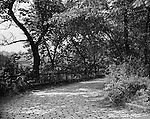 Pittsburgh PA:  View of a walking path in Frick Park - 1952. The park was created after a gift was made to the city of Pittsburgh by Henry Clay Frick.  When he died in 1919, Frick bequeathed to the city 151 acres south of his Point Breeze mansion, Clayton, and provided a $2 million trust fund to help create the park and assist with its long-term maintenance. The city began moving in earnest to create the park in 1925, when it acquired 190 additional acres, presumably with the goal to create a park of similar size and scope to Schenley and Highland Parks. The park officially opened in 1927.