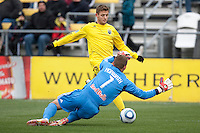 Mar 26, 2011; Columbus, OH, USA; New York Red Bulls goalkeeper Alex Horwath (1) makes a save on Columbus Crew midfielder/forward Robbie Rogers (18) during their match at Columbus Crew Stadium.