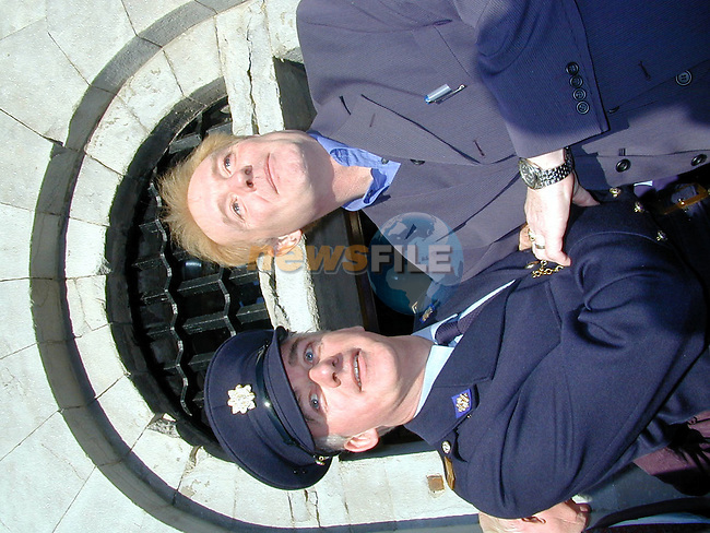 Sgt. Pius McSweeney from Drogheda escorts Les Battersby into the old Drogheda Jail  to open  the newly refurbished Eddies Hardware at the opening of the 12,000 sq ft superstore.Picture by Fran Caffrey Newsfile