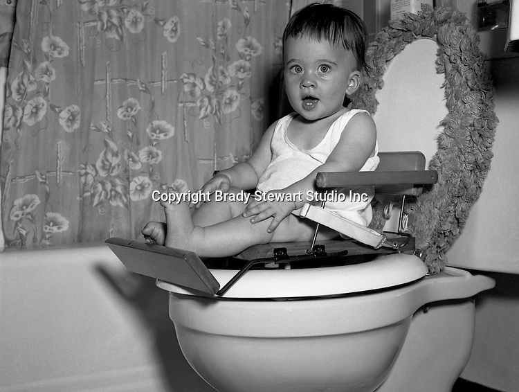 Pleasent Hills PA: Cathleen Brady Stewart learning with the new Cher-Chair Nursery Seat - 1947.  Cathleen is the oldest child of Brady Stewart Jr and Marjorie Zapp Stewart.