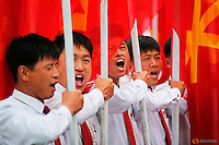 PLEASE TPX THIS PICTURE<br /> <br /> Students carrying party flags shout slogans as they march past North Korean leader Kim Jong Un during a mass rally and parade in the capital's main ceremonial square, a day after the ruling party wrapped up its first congress in 36 years by elevating him to party chairman, in Pyongyang, North Korea May 10, 2016.  REUTERS/Damir Sagolj