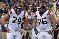 Virginia Tech center Andrew Miller(74), quarterback Logan Thomas (middle) and guard David Wang (76) huddle together. The Pitt Panthers defeated the Virginia Tech Hokies 35-17 at Heinz field in Pittsburgh, PA on September 15, 2012.