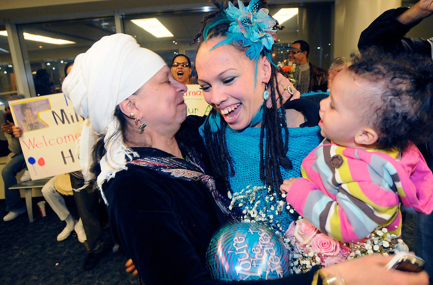 Client: Milwaukee Journal Sentinel<br /> American Idol contestant and Milwaukee resident Naima Adedapo is greeted by her mother Adekola Adedapo and her one-year-old daughter Abiola as she arrived at Mitchell Airport on Tuesday, April 5, 2011. Naima finished high in the American Idol competition and will tour with the top stars of the show this summer. Ernie Mastroianni photo