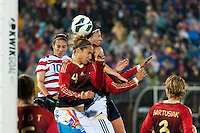 Carli Lloyd (10) and Abby Wambach (14) of the United States (USA) goes up for a header with Babett Peter (4) of Germany (GER). The United States (USA) and Germany (GER) played to a 2-2 tie during an international friendly at Rentschler Field in East Hartford, CT, on October 23, 2012.