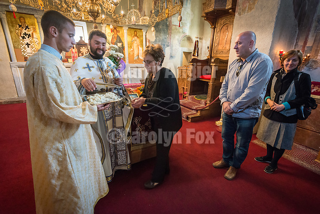 Parishioners venerate the cross at the end of liturgy service, Church of the Ascension of Jesus Christ at the Monastery Mileseva, Serbia originally built in the 13th century. Reverend Hieromonk Leontije, monastery priest